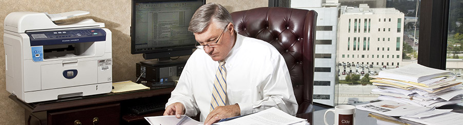 Orlando Attorney Clay Townsend sitting at his desk. Clay is a key member of the Morgan and Morgan Business Trial Group.